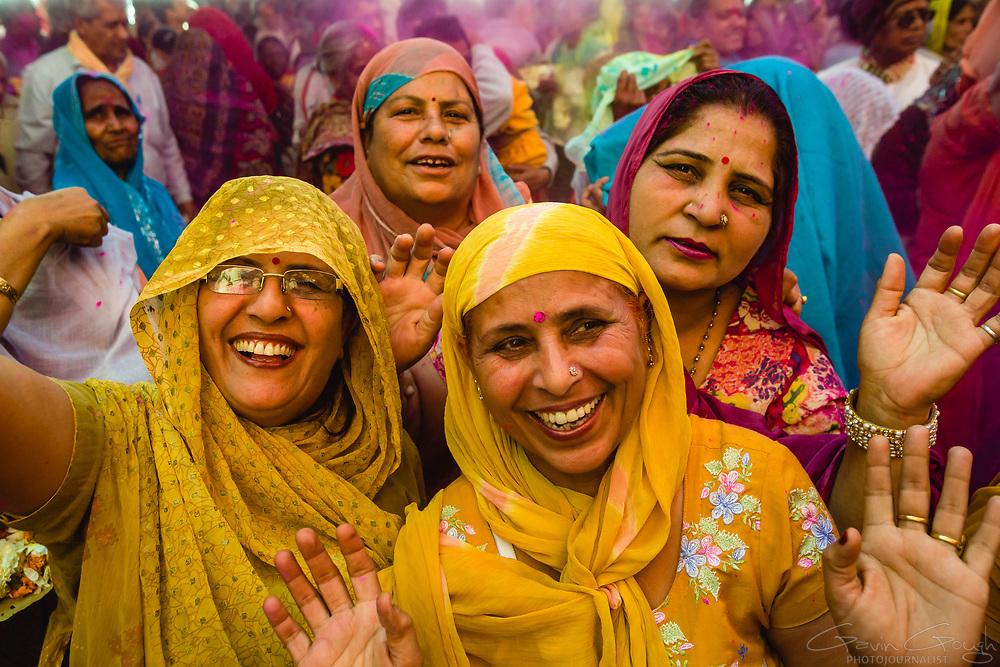 Women celebrating the Hindu Holi festival inside the temple, Radha Rani Temple, Barsana, India