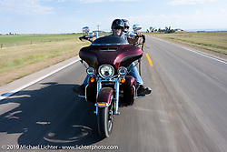Kristi and Mathew Long on the Harley Owners Group (HOG) ride out from the Full Throttle Saloon during the Sturgis Motorcycle Rally. SD, USA. Thursday, August 12, 2021. Photography ©2021 Michael Lichter.