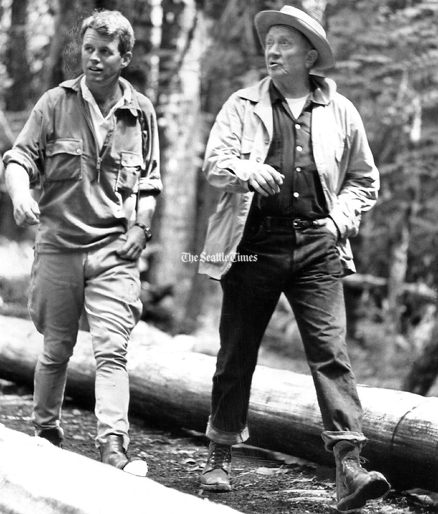 Preferring feet to saddles, Kennedy and Douglas hike in the wilderness of the Olympic National Park near the Elwha River. (Paul V. Thomas / The Seattle Times, 1962)