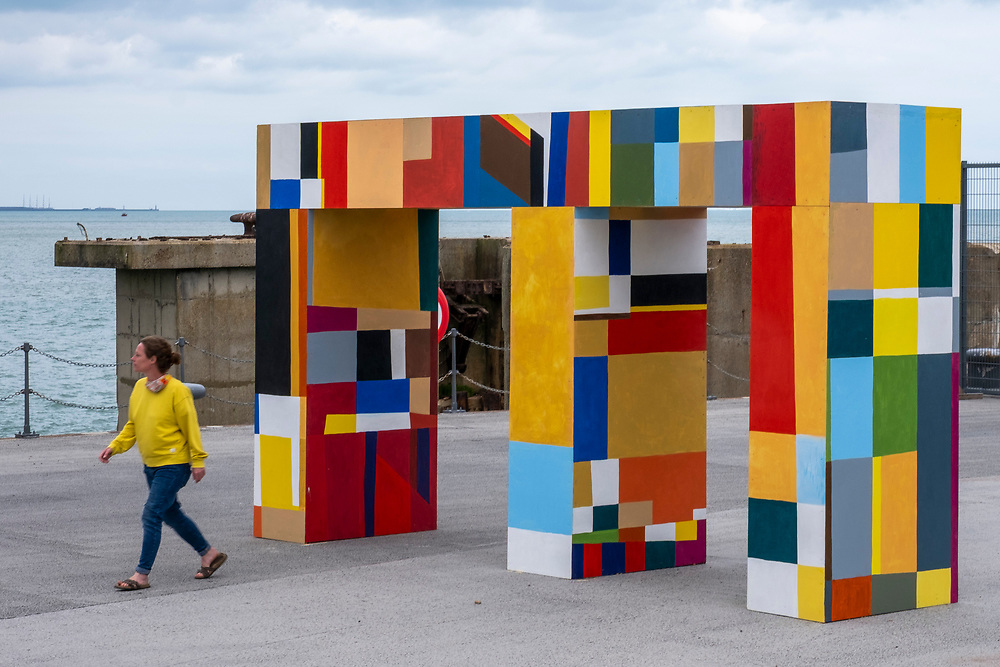 Gateways of the sea by artist Atta Kwami on 15th of July 2021, in Folkestone, United Kingdom. The free standing three-dimensional artworks are an imposing but joyful asymmetric double archway stands at the junction of four pathways in the centre of the Harbour Arm. The artwork is part of the Creative Folkestone Triennial 2020, The Plot, which sees 27 newly commissioned artworks appearing around the south coast seaside town. The new work builds on the work from previous triennials making Folkestone the biggest urban outdoor contemporary art exhibition in the UK. (photo by Andrew Aitchison / In pictures via Getty Images)