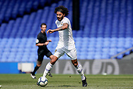 Izzy Brown of Leeds United U23 on the attack during the U23 Professional Development League match between U23 Crystal Palace and Leeds United at Selhurst Park, London, England on 15 April 2019.