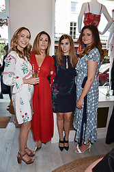 Left to right, Lavinia Brennan, Natalie Pinkham, Princess Beatrice Of York and Lady Natasha Rufus Isaacs at the launch of the Beulah Flagship store, 77 Elizabeth Street, London England. 16 May 2018.