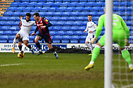 Tranmere Rovers striker Kaiyne Woolery under pressure by Bolton Wanderers defender Gethin Jones during the EFL Sky Bet League 2 match between Tranmere Rovers and Bolton Wanderers at Prenton Park, Birkenhead, England on 23 January 2021.