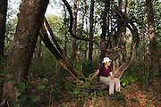 Liana Welty sits on the hanging vines of a strangler fig in Royal Chitwan National Park, Terai, Nepal.