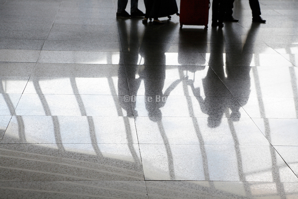 airport terminal with group of people meeting up