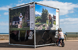 Edinburgh Science Festival, Edinburgh, Scotland, United Kingdom: <br /> Pictured: People passing by take a look at the photos in the exhibition.<br /> The 2021 Edinburgh Science Festival (26 June – 11 July) focuses on the climate challenges and opportunities ahead and the first of its events opens today with a free outdoor photographic exhibition called Human Nature. The exhibition is a photographic journey around the world to show how we connect to nature, and features work of critically acclaimed photographers, including Lucas Foglia whose photographs  feature in National Geographic and New York Times and Anna Deacon, Edinburgh-based photographer and author known for portraits of wild swimmers.<br /> Sally Anderson | EdinburghElitemedia.co.uk