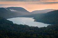 Morning Sunlight illuminates the fog over Lake of the Clouds - Porcupine Mountains Wilderness State Park
