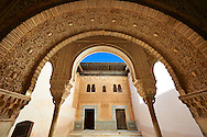 """Arabesque Moorish architecture of an inner courtyard  of the Palacios Nazaries,  Alhambra. Granada, Andalusia, Spain. . The Alhambra is a palace and fortress complex located in Granada, Andalusia, Spain. It was originally constructed as a small fortress in 889 CE on the remains of ancient Roman fortifications. The Alhambra was renovated and rebuilt in the mid-13th century by the Arab Nasrid emir Mohammed ben Al-Ahmar of the Emirate of Granada, who built its current Alhambra palace and walls. The Alhambra was converted into a royal palace in 1333 by Yusuf I, Sultan of Granada. The decoration of The Alhambra consists for the upper part of the walls, as a rule, of Arabic inscriptions—mostly poems by Ibn Zamrak and others praising the palace—that are manipulated into geometrical patterns with vegetal background set onto an arabesque setting (""""Ataurique""""). Much of this ornament is carved stucco (plaster) rather than stone. Tile mosaics (""""alicatado"""") of The Alhambra, with complicated mathematical patterns (""""tracería"""", most precisely """"lacería""""), are largely used as panelling for the lower part. .<br /> <br /> Visit our SPAIN HISTORIC PLACXES PHOTO COLLECTIONS for more photos to download or buy as wall art prints https://funkystock.photoshelter.com/gallery-collection/Pictures-Images-of-Spain-Spanish-Historical-Archaeology-Sites-Museum-Antiquities/C0000EUVhLC3Nbgw <br /> .<br /> Visit our ISLAMIC HISTORICAL PLACES PHOTO COLLECTIONS for more photos to download or buy as wall art prints https://funkystock.photoshelter.com/gallery-collection/Islam-Islamic-Historic-Places-Architecture-Pictures-Images-of/C0000n7SGOHt9XWI"""