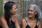 Tilani and Silvinha laughing outside Silvinha's house Jardim São Marcos favela, Cubatão