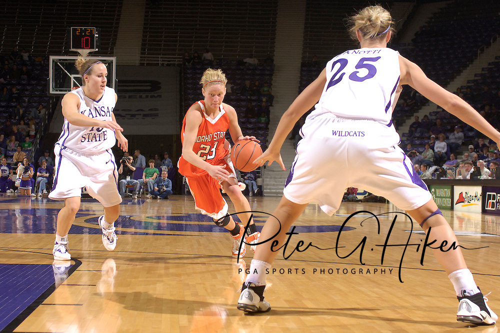 Idaho State guard Andrea Lightfoot (C) drives between Kansas State's Kimberly Dietz (L) and Danielle Zanotti (R), during the first half at Bramlage Coliseum in Manhattan, Kansas, March 17, 2006.  K-State defeated the Bengals 88-68 in the first round of the WNIT.