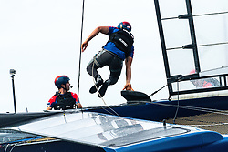 Rome Kirby, helm of U.S. SailGP Team, leaps across his teams F50 during a training sail prior to Sydney SailGP, Event 1 Season 2 in Sydney Harbour, Sydney, Australia. 23 February 2020. Photo: Drew Malcolm for SailGP. Handout image supplied by SailGP
