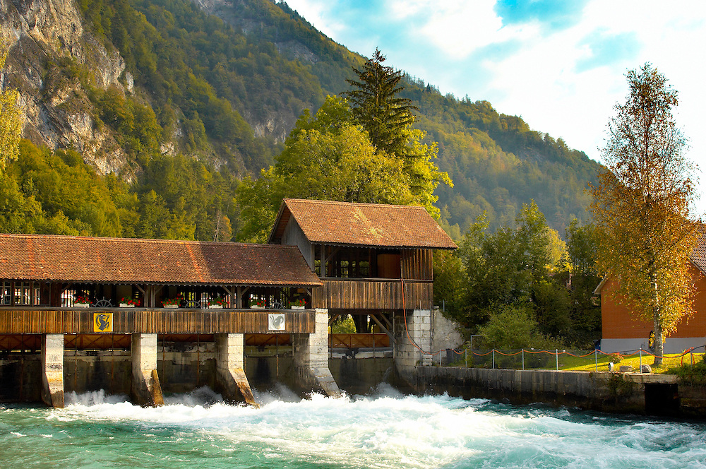 Interlaken Bernese Alps Switzerland - River and wooden wier .<br /> <br /> Visit our SWITZERLAND  & ALPS PHOTO COLLECTIONS for more  photos  to browse of  download or buy as prints https://funkystock.photoshelter.com/gallery-collection/Pictures-Images-of-Switzerland-Photos-of-Swiss-Alps-Landmark-Sites/C0000DPgRJMSrQ3U