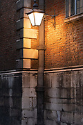 The warm glow of a street lantern illuminates a wall in Bow Churchyard, in the City of London, the capitals financial district, on 26th February 2021, in London, England.