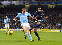 11/12/2004 - FA Barclays Premiership - Manchester City v Tottenham Hotspur - The City of Manchester Stadium.<br />Tottenham Hotspur's Fredi Kanouté scores the winning goal past Manchester City's Richard Dunne.<br />Photo:Jed Leicester/Back Page Images