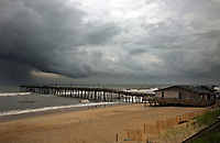 NC01268-00...NORTH CAROLINA - Storm clouds coming in off the Atlantic Ocean at Nags Head Fishing Pier on the Outer Banks in the town of Nags Head.
