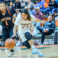 Wingate Bear Chelsey Gibson (23) chases a lose ball on the baseline ahead of Gallup Bengal Jordan Hanley (1) during the Wingate Holiday Classic girls basketball tournament at Wingate High School Friday.