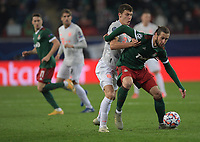 MOSCOW, RUSSIA - OCTOBER 27: Benjamin Pavard of FC Mayern Muenchen tussles with Grzegorz Krychowiak of Lokomotiv Moskva during the UEFA Champions League Group A stage match between Lokomotiv Moskva and FC Bayern Muenchen at RZD Arena on October 27, 2020 in Moscow, Russia. (Photo by MB Media)
