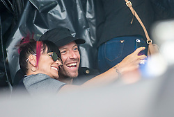 Lily Allen and Chris Martin take a selfie as Ed Sheeran plays the main stage, BBC Radio 1's Big Weekend Glasgow. Saturday at Glasgow Green, BBC Radio 1's Big Weekend Glasgow 2014.