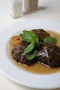 A bowl of stuffed cabbage leaves filled with rice and meat