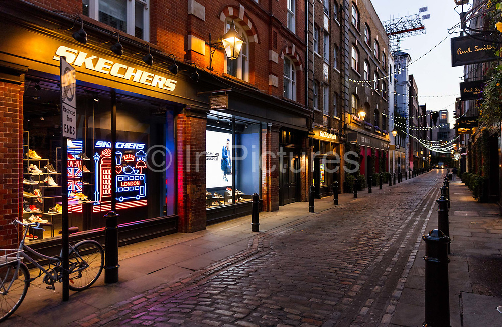 Floral Street, Covent Garden, normally crowded with  tourists and shoppers, was deserted at 6.00pm Saturday night during the Coronavirus pandemic on 4th April 2020 in London, United Kingdom. The government clampdown includes the closure of most shops, bars and theatres throughout the country.