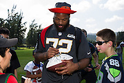 January 30 2016: Seattle Seahawks Michael Bennett signs autographs after the final Pro Bowl practice at Turtle Bay Resort on Oahu, HI. (Photo by Aric Becker/Icon Sportswire)