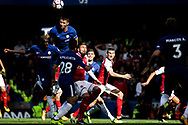 Chelsea and Arsenal players watch on as Gary Cahill of Chelsea © heads the ball away. Premier league match, Chelsea v Arsenal at Stamford Bridge in London on Sunday 17th September 2017.<br /> pic by Kieran Clarke, Andrew Orchard sports photography.