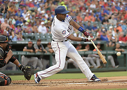 July 28, 2017 - Arlington, TX, USA - The Texas Rangers' Elvis Andrus connects for a single during the first inning against the Baltimore Orioles at Globe Life Park in Arlington, Texas, on Friday, July 28, 2017. (Credit Image: © Max Faulkner/TNS via ZUMA Wire)