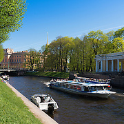 Tour Boat With Tourists In Moika River Canal, St Petersburg