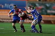 Hadleigh Parkes of the Scarlets is tackled by Adam Warren (l) and Nic Cudd ® of the Dragons. Guinness Pro12 rugby match, Scarlets v Newport Gwent Dragons at the Parc y Scarlets in Llanelli, West Wales on Saturday 8th October 2016.<br /> pic by  Andrew Orchard, Andrew Orchard sports photography.