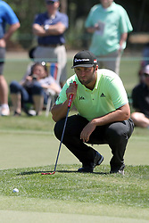 March 23, 2019 - Palm Harbor, FL, U.S. - PALM HARBOR, FL - MARCH 23: Jon Rahm lines up a putt during the third round of the Valspar Championship on March 23, 2019, at Westin Innisbrook-Copperhead Course in Palm Harbor, FL. (Photo by Cliff Welch/Icon Sportswire) (Credit Image: © Cliff Welch/Icon SMI via ZUMA Press)