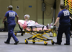Emergency personnel evacuate a elderly resident from the city at the Savannah Civic Center during a mandatory evacuation for Hurricane Irma on Saturday, September 9, 2017, in Savannah, Ga. Officials are expecting 1,500 to 3,000 without transportation to leave by buses that are being provided. Photo by Curtis Compton/Atlanta Journal-Constitution/TNS/ABACAPRESS.COM