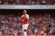 Theo Walcott of Arsenal looks on dejected after the final whistle. Barclays Premier League, Arsenal v West Ham Utd at the Emirates Stadium in London on Sunday 9th August 2015.<br /> pic by John Patrick Fletcher, Andrew Orchard sports photography.