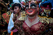 A dancer talks on her cell phone before she performs in the celebrations.
