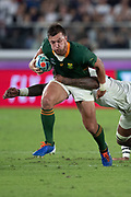 Handre Pollard of South Africa is tacked by Courtney Lawesof England during the Rugby World Cup  final match between England and South Africa at the International Stadium ,  Saturday, Nov. 2, 2019, in Yokohama, Japan. South Africa defeated England 32-12. (Florencia Tan Jun/ESPA-Image of Sport)