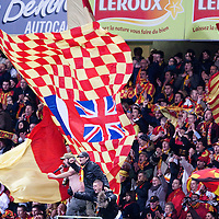 28 November 2009: Fans of Lens hold banners during the French League 1 football match between RC Lens and Olympique de Marseille, at Stadium Bollaert, in Lens, France.