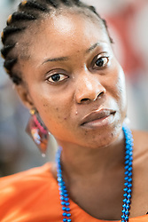 """6 December 2017, Abidjan, Côte d'Ivoire: Gresse from Côte d'Ivoire, a woman representive of the organization BLETY, attends ICASA 2017 as part of the organization's work for """"no blame, only education"""" of people who make a living as sex workers. The organization supports sex workers through education in the field, working to prevent violence, and working for awareness-raising on how sex workers can protect themselves against HIV in their work. The19th International Conference on AIDS and STIs in Africa (ICASA) 2017 gathers thousands of researchers, medical professionals, academics, activists and faith-based organizations from all over the world, all looking to overcome the HIV epidemic and eliminate AIDS as a public health threat."""