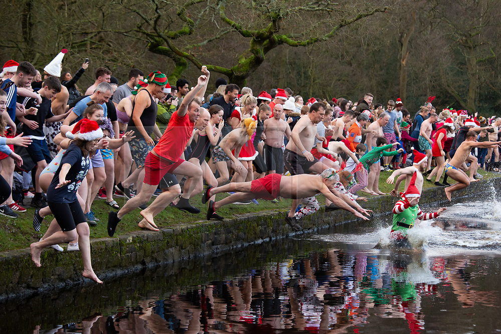 © Licensed to London News Pictures. 25/12/2019. Sutton Coldfield, West Midlands, UK. Christmas Day swim, Blackroot pool, Sutton Coldfield, West Midlands. The Christmas Day swim has become an annual tradition with swimmers of all ages taking part in the early morning chilly festive dip. Participants arrive from 9am, to get ready for the plunge into the water at 10am. Photo credit: Dave Warren/LNP