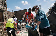 Volunteers remove damaged items from a Wendy's restaurant in the Longfellow neighborhood of Minneapolis, Minnesota on Monday, June 1, 2020. The restaurant was razed to the ground during the civil unrest that overwhelmed the Twin Cities in the final days of May following the death of George Floyd at the hands of Minneapolis Police Department officers.