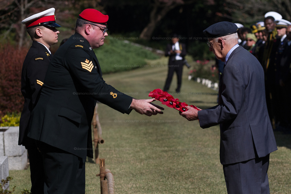 A member of the Royal Air Force Association lays a wreath during the ceremony for Remembrance Sunday at the Commonwealth War Graves Cemetery in Hodogaya, Yokohama, Japan. Sunday November 13th 2016. Each year representatives of the Commonwealth nations, along with American and other European nations that lost servicemen fighting the Japanese in World War 2, hold a multi-faith service of remembrance at this cemetery. This is the only cemetery for war dead in japan that is managed by the Commonwealth War Graves Commission.
