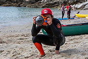 A photographer with waterproof housing around his camera heads out with paddles boarders and surfers from Swanpool Beach for a mass gathering of G7 paddle-out protesters organised by the environmental campaigners Surfers Against Sewage at Gyllyngvase Beach on June 12, 2021 in Falmouth, United Kingdom.  Environmental protest groups have gathered in Cornwall as the UK Prime Minister, Boris Johnson, hosts leaders from the G7 nations for a world summit.