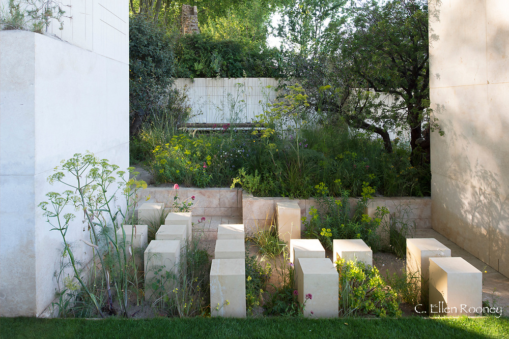 The M&G Garden designed by James Basson and winner of the best show garden award at the RHS 2017 Chelsea Flower Show.  The unusual design represents an abandoned Maltese limestone quarry containing wild flowers, evergreens and grasses planted around pillars. London, UK