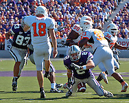 Kansas State's Marcus Watts (2) blocks Oklahoma State punter Matt Fodge's (18) punt in the second quarter.  The Wildcats returned the blocked punt for a touchdown at Bill Snyder Family Stadium in Manhattan, Kansas, October 7, 2006.  The Wildcats beat the Cowboys 31-27.<br />