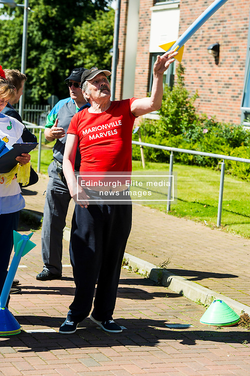 Pictured: Ex-soldier Andrew Flamson was in the lead with his fine technique.<br /> <br /> First-ever care home games tournament took place over two days at Edinburgh's Inchview Care home. More than 90 athletes from other care homes gathered to  compete in events including javelin, curling and dancing. <br /> <br /> <br /> <br /> Ger Harley   EEm 27 July 2016