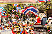 01 FEBRUARY 2014 - BANGKOK, THAILAND: Anti-government protestors march through Chinatown in Bangkok. The anti-government protest movement, led by the People's Democratic Reform Committee (PDRC) organized a march through the Chinatown district of Bangkok Saturday and disrupted the city's famous Chinese New Year festival. Some streets were blocked and protest leader Suthep Thaugsuban walked through the neighborhood collecting money. The march was in advance of massive protests the PDRC has promised for Sunday, Feb. 2 in an effort to block Thais from voting in the national election.     PHOTO BY JACK KURTZ
