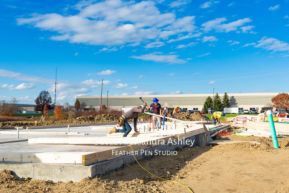 Framing crew begins assembling walls at building site of new physical therapy and wellness clinic.