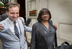 © Licensed to London News Pictures. 02/05/2017. London, UK. Shadow Home Secretary DIANE ABBOTT is surrounded by reporters as she leaves Milbank Studios in Westminster, with the help of Lord Prescott's son David Prescott (left) after an appearance on the Daily Politics program. DIANE ABBOTT made a number of costing errors during a radio interview about  a Labour election pledge on increased policing numbers.  Photo credit: Peter Macdiarmid/LNP