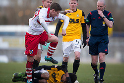 Stirling Albion's Ross Forysth over East Fife's Kevin Smith and starts a small melee. <br /> East Fife 1 v 0 Stirling Albion, Scottish Football League Division Two game played atBayview Stadium, 20/2/2106.