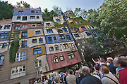 The Hundertwasserhaus, the first and most famous public housing project by Austrian artist and architekt Friedensreich Hundertwasser. Tourist group visiting the house.
