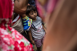 August 28, 2017 - Jakarta, Jakarta, Indonesia - Rohingya and Bangladeshi Muslim Children stand outside the the UNHCR during a protest in front of the United Nations High Commissioner for Refugees (UNHCR) office in  Jakarta, Indonesia on August 28, 2017. Dozens of Rohingya and Bangladeshi migrants protested in front of UNHCR office urging Myanmar's government to stop the violence against the Rohingya people. Thousands of Rohingya Muslims fleeing violence in Myanmar were trying to cross the border with Bangladesh as fresh fighting erupted in Myanmar's northwestern Rakhine state, India Today reported on Saturday (August 26). Hundreds of Rohingya were crossing into Bangladesh near the border village of Gumdhum as gun shots were heard from the Myanmar side. The death toll from widespread attacks staged by Rohingya insurgents on Friday has climbed to 96, including nearly 80 insurgents and 12 members of the security forces. (Credit Image: © Afriadi Hikmal via ZUMA Wire)