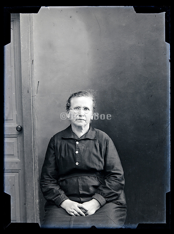 portrait of an sitting elderly woman looking at the camera circa 1930s